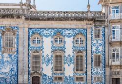 Traditional historic facade in Porto decorated with blue tiles azulejos of Carmo Church (Igreja do Carmo) with azulejos in Porto, Portugal.