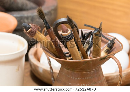 Traditional historical medieval writing calligraphy illumination tools, pen, nibs, knife, brush, pots ink #726124870