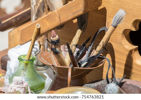 Traditional historical medieval writing calligraphy illumination tools, pen, nibs, knife, brush, pots ink #754763821