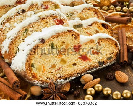 Traditional homemade stollen with dried fruits and nuts. Shallow dof.