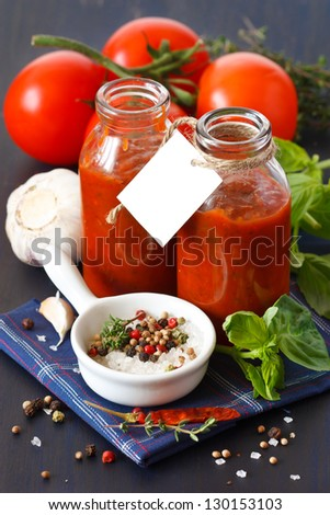 Traditional homemade tomato sauce with empty name tag and ingredients
