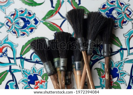 Traditional horse hair and wood brushes used for Ebru the Turkish Art of Marbling Stok fotoğraf ©