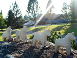 Traditional horses from Dalarna, Sweden - dalahästar. A group of sculptures in a Swedish countryside