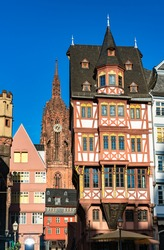 Traditional house and the Cathedral in Frankfurt, Germany