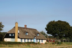 Traditional house in Denmark with thatched roof