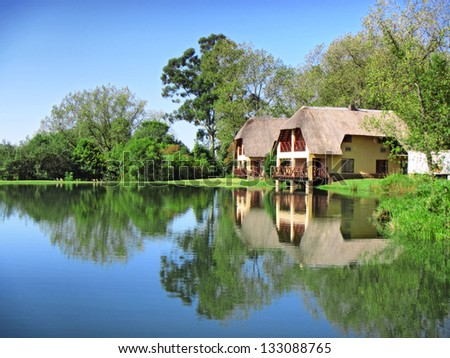 Traditional house next to lake. Shot in Monks Cowl area, Drakensberg Mountains, South Africa.