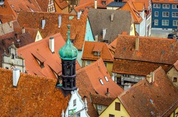 Traditional houses and buildings in old medieval town of Rothenburg ob der Tauber with orange roofs, Bavaria romantic road of Germany.