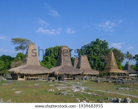 Traditional houses with high thatched roof in Tosi village, Kodi, West Sumba island, East Nusa Tenggara, Indonesia Zdjęcia stock ©