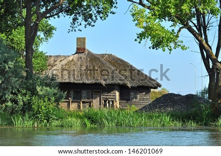 Traditional houses with thatched roof in the Danube delta