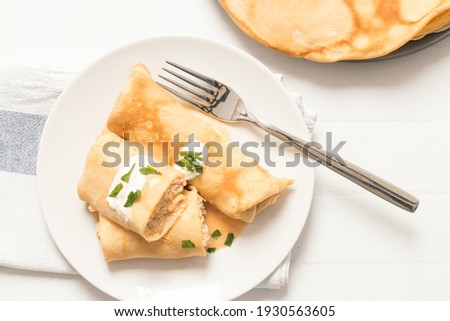 Traditional hungarian crepes called Hortobagyi Palacsinta (Hortobagy Crepes) filled meat and served with sauce  Stock fotó ©