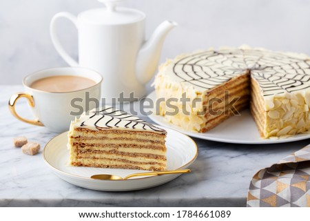 Traditional Hungarian Esterhazy cake, torte with cup of coffee. Marble background. Close up. Zdjęcia stock ©