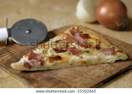 Traditional Hungarian pizza with onion, bacon, sausage and sour-cream ...