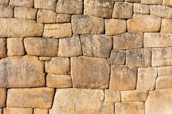 Traditional Inca Wall and stonework in the lost city of Machu Picchu, Cusco, Peru.