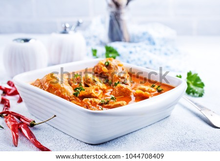 Traditional Indian dish chicken. Spicy chicken curry in bowl  #1044708409