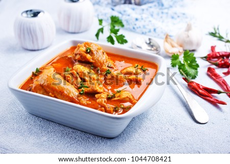 Traditional Indian dish chicken. Spicy chicken curry in bowl  #1044708421