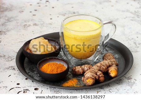 Traditional indian drink turmeric golden milk .