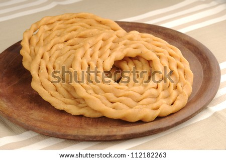 traditional indian snack,Murukku is a savoury snack popular in India and Sri Lanka.