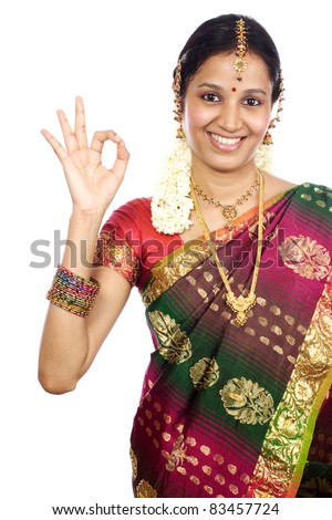 Traditional Indian Young woman making Ok sign