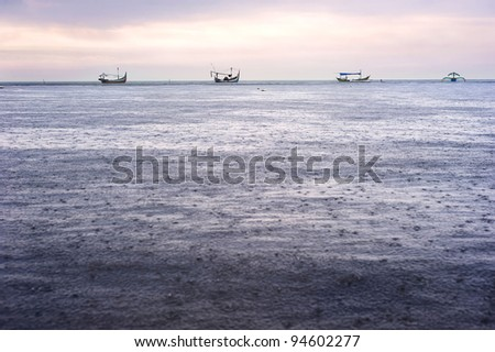 Traditional Indonesian fishing boats in the rain