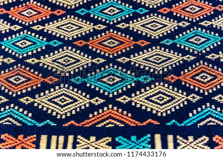 traditional Indonesian natural cotton fabric with colorful zigzag pattern #1174433176