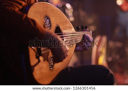 Traditional Instrument from Middle East and Asia called Oud or Ud. A Musician Playing Note on Oud