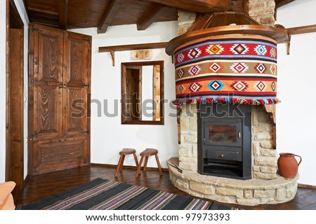 Traditional Interior Design Of Room With Fireplace In Old Wooden ...