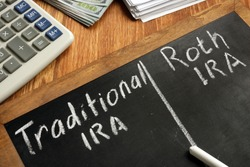 Traditional IRA vs Roth IRA written on blackboard.