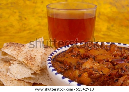 "Traditional Iranian Eggplant dip ""Kashk e baadenjaan"" with tea"