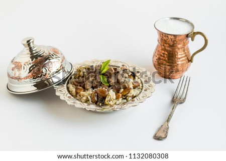 Traditional Islamic Feast,braised meat and pilaff (Kavurma/Pilav) in stylish copper bowl with buttermilk and metal fork,on the white surface. #1132080308