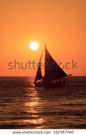 Traditional Island Sailboats go out for Sunset Cruises