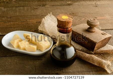 Traditional Italian balsamic vinegar and parmesan cheese