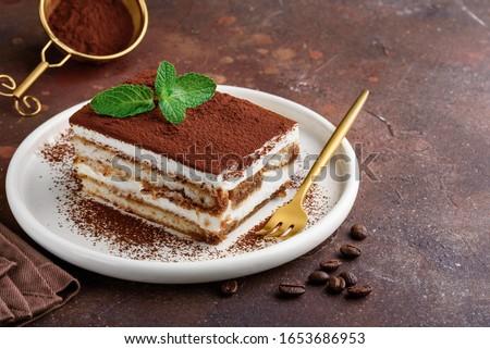 Traditional italian dessert tiramisu on a white plate. Copy space. Selective focus Photo stock ©