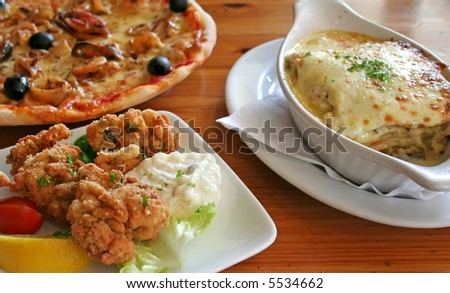 Traditional italian food pizza lasagna fried oysters