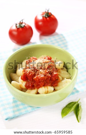 Traditional Italian gnocchi with tomato sauce and basil