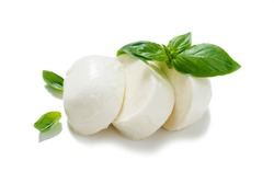 Traditional Italian Mozzarella cheese and basil on white background .