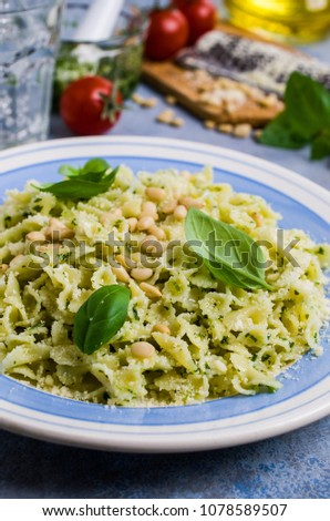 Traditional Italian pasta with pesto in a plate on the table. Selective focus. #1078589507