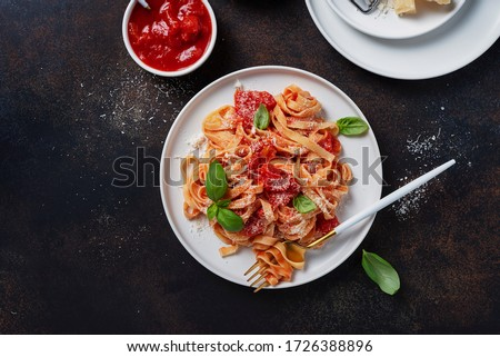 Traditional italian pasta with tomato, basil and parmesan. Top view image with a copy space