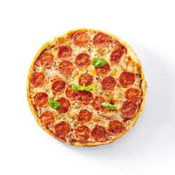 Traditional italian pepperoni pizza with salami, chili pepper, mozzarella cheese, fresh basil, tomatoes and tomato sauce isolated. Delicious italy salami flatbread cutout, tasty fast food topview