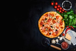 Traditional Italian pizza, vegetables, ingredients on a dark metallic background. Pizza is cooking in the oven. Pizza menu. View from above. Space for text.