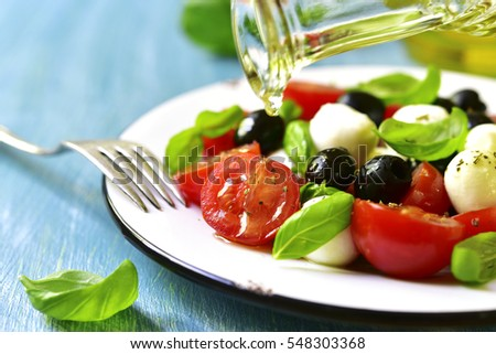 "Traditional italian salad ""Caprese"" with black olives. #548303368"