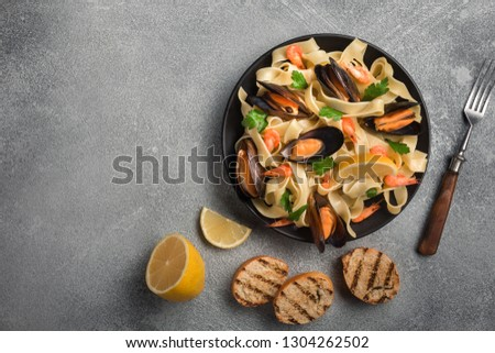 Traditional italian seafood pasta with clams Spaghetti alle Vongole on stone background. Top view #1304262502