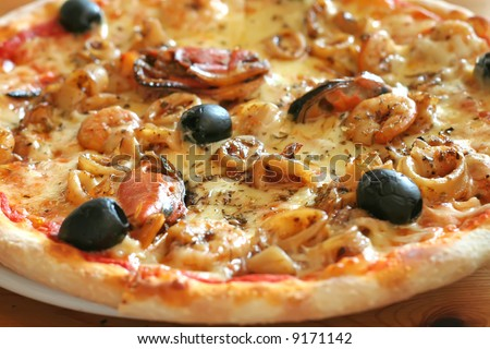 Traditional italian seafood pizza with prawns and mussels