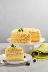 Traditional Italian sponge cake - Mimosa cake, usually eaten during the March 8th for International Women's Day.  Vertical image, light background. Selective focus.