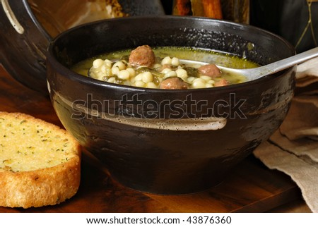 stock photo Traditional Italian wedding soup in rustic stoneware bowl with