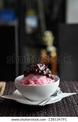 Traditional Japanese Dessert , A Bowl of Red Bean Sweet with red ice on wood pattern
