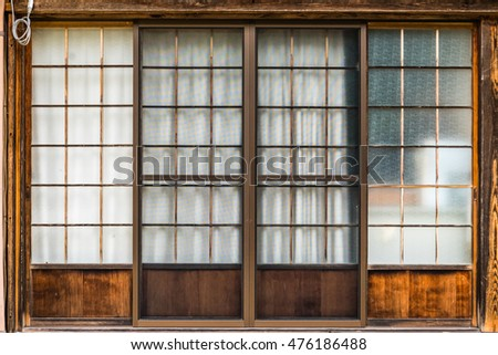 Traditional Japanese door with sliding wooden frame #476186488