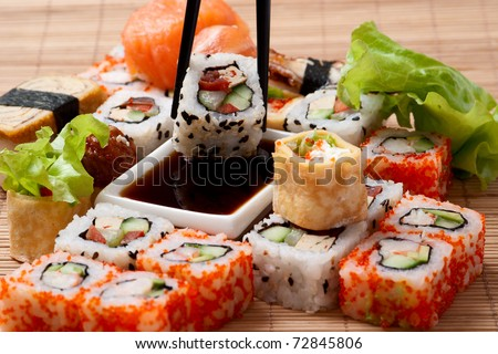 Traditional Japanese food Sushi. Closeup japanese sushi on a bamboo napkin. Sushi collection