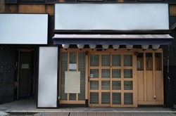 Traditional Japanese restaurants and shops style front view, Japanese wooden slide door. The blank banner and paper on the stand for advertisement,