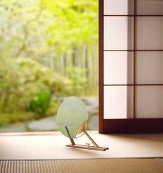 Traditional Japanese room. Uchiwa fan on Tatami mat.