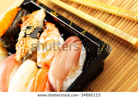 Traditional japanese sushi close-up and chopsticks